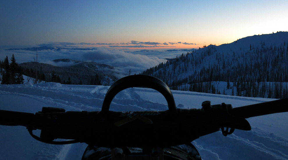 sunset snowmobiling in the Wallowas